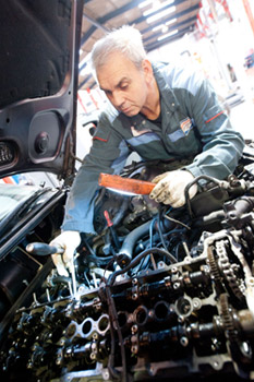 Mechanic Inspecting Car Engine at Westhill Garage